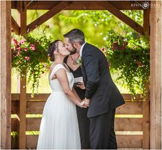 Wedding ceremony kiss at Chatfield Botanic Gardens in the open air field in front of the gazebo in Colorado. - April O'Hare Photography http://www.apriloharephotography.com #ChatfieldBotanicGardens #ColoradoWedding #BarnWedding #FarmWeddingPhoto #OutdoorWedding #DenverWeddingPhotographer #FarmWedding