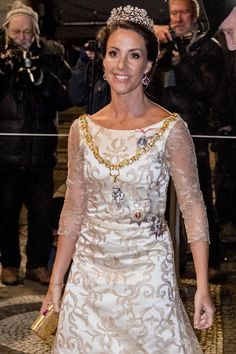 Princess Marie of Denmark looked absolutely breathtaking in a crimsom coloured gown and a glittering tiara as she attended a traditio...