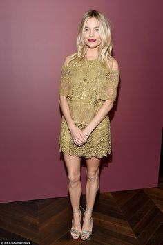 Gilt-y pleasure: The American Sniper actress teamed the short frock with a pair of metallic gold open-toed heels