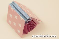 A cute and useful origami blizzard book, follow a step by step tutorial video for this pretty project, perfect for a gift and practical too!