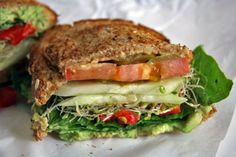 Avocado used as a spread, sprouts, tomato, cucumber, spinach, roasted bell pepper and serve on yr favorite bread. Easy