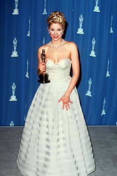 Where: Academy Awards in 1996 Why: Sorvino looks like a winner in this classic Oscars fashion choice of princess gown and major jewels.