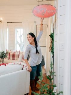 Host Joanna Gaines decorates the Magnolia House bed & breakfast for Christmas, as seen on Fixer Upper.