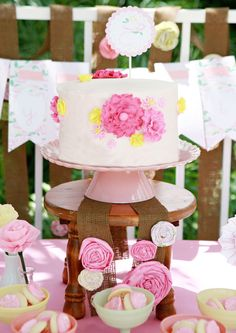 love the idea of a pink flower garden party theme for a girl's birthday party!