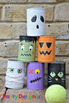 Super fun tin can bowling activity for kids this Halloween. Make this fun Halloween Craft with the kids. They are also great desk tidies and double up nicely as Halloween Pen Pots. kids crafts toddlers Super fun Tin Can Bowling Game Dulceros Halloween, Adornos Halloween, Manualidades Halloween, Fun Halloween Crafts, Halloween Disfraces, Holidays Halloween, Halloween Makeup, Outdoor Halloween, Halloween Projects