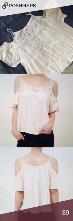 Cream Lace Cutout Top 100% rayon soft and flowy top with cutout sleeves. Color is cream, with Ivory lace in front,never been worn, in very good condition Tops