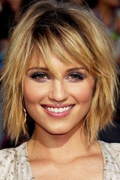 Medium length messy blond hairstyle with fringe