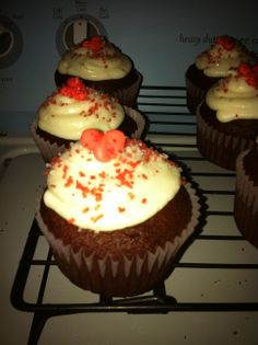 Cupcakes with a royal heart topper.
