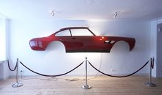Half a Ferrari on your wall, sir? Don't mind if I do.