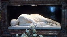When the tomb of St. Cecilia was opened in 1599, her body was incorrupt, so the artist Stefano Maderno made this marble statue, testifying that she is depicted just as he saw her. (Notice the mark where she was struck in the neck with a sword, yet it is said she still lived for 3 days.) She died with 3 fingers outstretched on her right hand, expressing her belief in the Three Persons of the Blessed Trinity, and two on he left hand, signifying the Divine and Human Natures of Christ.
