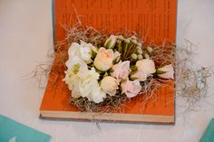 Flowers in a vintage book- wedding centerpiece. #LibraryWedding