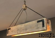 Rectangular industrial suspension made from reclaimed wood with pulley and chains. This product can be custom-made to your tastes and needs.