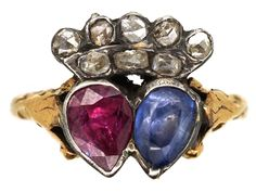 A lovely Georgian ring set with a pear shaped sapphire and ruby with a crown of rose diamonds. A bond of love and a beautiful ring to wear.
