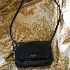 Black crossbody Kate Spade bag Like new. Worn once. Gold zipper and lettering. Pink inside the bag like seen in the photos. kate spade Bags Crossbody Bags