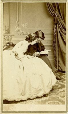 This photo makes me curious. You rarely see anything but stoic sittings, especially between a man and a woman. It's also unique to see a woman reading at that time in history. Wish I knew the back story. Victorian Photos, Antique Photos, Vintage Pictures, Vintage Photographs, Old Pictures, Victorian Era, Victorian Fashion, Old Photos, Vintage Dior