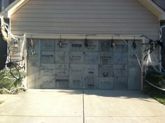 Garage door mausoleum made with foam board cut into individual squares. Attached with glued on magnets. Awesome!