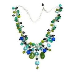 Green and Blue Glass Bead Charm Necklace Handmade and Fair Trade. This flashy bead necklace features a mixture of smooth and faceted blue and green glass beads. The necklace measures 17 inches, plus a 2 inch extender, on a silver-toned brass chain.