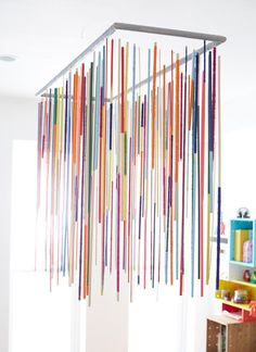Embrace Color by painting dowels and hanging as a light fixture.