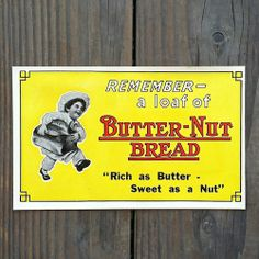 """Old vintage BUTTER-NUT BREAD Grocery Store window decal from the 1920s. Measures approximately 4"""" x 7"""". Pictures BAKER BOY with loaf of bread. """"REMEMBER-a loaf of BUTTER-NUT BREAD, Rich as Butter-Sweet as a Nut"""". New old stock never used nor circulated in very good condition. Handle with care as stock if frail. 