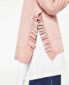 Love the surprise ruffles and color of this sweater. Like the layering.