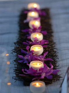 Purple flower & candle table runner centerpiece