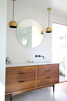 Faucet / wood cab / pendant lights. Mid-Century Modern Bathroom Ideas-10-1 Kindesign