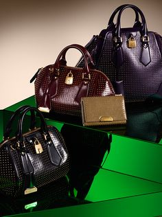 New studded bags with metal lock and key inspired by vintage Burberry luggage