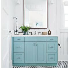 The vanity in this Sullivan's Island master bath is painted Blue Green by Farrow & Ball. | Coastalliving.com