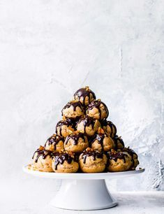 Profiterole Tower with Chocolate and Hazelnuts Looking for an impressive dessert to serve family and friends? Check out this show-stopping chocolate and hazelnut profiterole stack. With creamy Nutella filling and crunchy hazelnut brittle, this stunning recipe is the perfect end to a dinner party