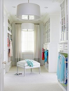Arranged more like your favorite little frock shop than a home-based closet, this spacious knockout tucks away scads of stuff but still seems serene by flipping conventional closet wisdom in a few brilliant ways. Low-level cubbies replace traditional wall-mount rods. And select hanging items face forward, as they would in a store, so that go-to bags or jackets are easy to grab as you run out the door.