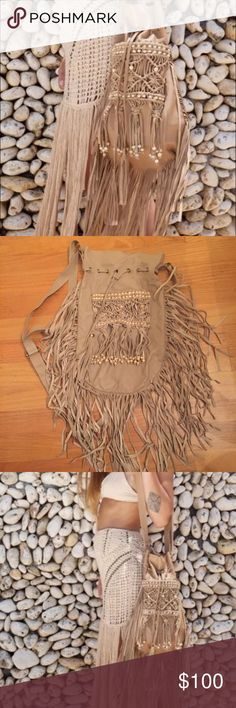 Free people FLOOK/ beige authentic leather purse Free people purse in great condition HAND MADE each purse from this company is one of a kind and unique in its own way Free People Bags Crossbody Bags