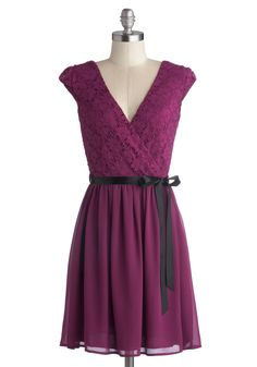 Champagne at Midnight Dress in Fuchsia | ModCloth.com | I love this dress because it incorporates a few of my favorite things: purple, lace, ribbons, flowy skirts, and cap sleeves.  I can picture myself wearing it to my cousin's wedding.  It looks so flattering and adorable!