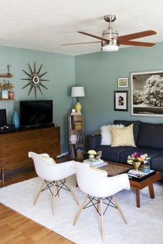 """I love the eclectic look of this room! It has that """"collected over time"""" feel to it, apparently the relaxing wall color is compliments of """"Halcyon Green"""" by Sherwin Williams."""