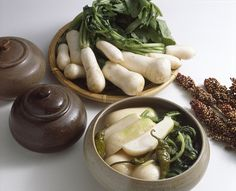 Dongchimi -  A variety of kimchi consisting of daikon radish, Chinese cabbage, scallions, fermented green chili, ginger, Korean pear and watery brine
