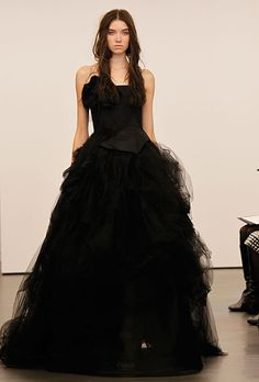 Brides: Vera Wang - Fall 2012. Strapless black organza ball gown wedding dress with a bow detail on the bodice, Vera Wang