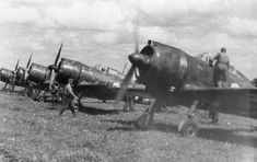 Hungarian fighters Re.2000 Heja from the 1/1 Fighter Squadron 'Dongo' ('Wasp') at the airport.