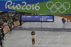 Ethiopia's Feyisa Lilesa crosses his arms as he crosses the finish line to win the silver medal in the men's marathon at the 2016 Summer Olympics in Rio de Olympic Medals, Olympic Games, African Union, Summer Olympics, Finish Line, Ethiopia, Good To Know, Marathon, Basketball Court