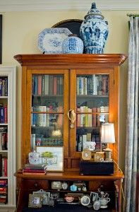 I recently pulled together this lovely display to fill the empty space above the secretary in my living room. Larger-scale blue and white pottery is an ideal choice for decorating high-up spaces, like on top of an armoire, because it is tall, beefy and bo Cabinet Decor, Display Cabinets, Blue And White China, Ginger Jars, White Decor, White Porcelain, Vignettes, Just In Case, Home Accessories
