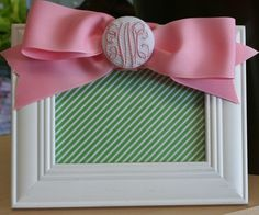 Such a cute frame :) Can't go wrong with bows and monograms