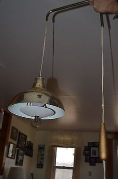 mid century modern gold weighted pull down hanging swag lamp mesh metal diffuser