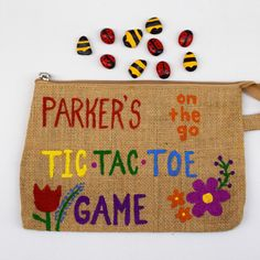 Personalized tic-tac-toe game for kids. Hand painted Ladybugs vs Bumblebees and travel bag. Painted board on back side of bag. Perfect for outings with the kiddos when they have to wait. From doctor visits to restaurants. Fun for the whole family!   TinyPaperCuts   Check out this item in my Etsy shop https://www.etsy.com/listing/272902178/personalized-travel-tic-tac-toe-game