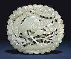 A LARGE WHITE JADE OPENWORK SPRING WATER OVAL PLAQUE