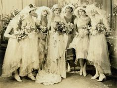 20s....How beautiful! I would love to wear a veil like theirs.....the curls...just angelic!