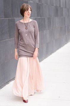 Put a mini dress over a maxi skirt for cool weather