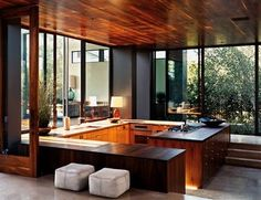sunken kitchen, lots of windows and gorgeous native wood ceiling