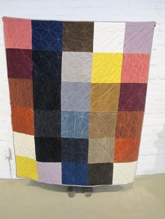 Color square quilt -  a patchwork of material used in past A.P.C. collections, hand-stitched over a thin padded lining. Designed by Jessica Ogden & Jean Touitou.