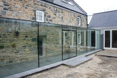 Structural glass link using frameless double glazed doors.