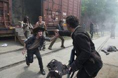 Rick releases the others from the train car as Daryl, Glen and Bob keep firing at the walkers