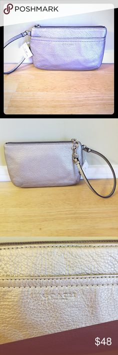 COACH This coach wrestling is new with tags never use, It's a large wristlet pewter in color Coach Bags Clutches & Wristlets