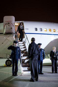 President Barack Obama greets First Lady Michelle Obama.